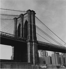 Brooklyn Bridge, c. 1992 (radiorocky) Tags: brooklyn bridge nyc newyorkcity blackwhite 1990s architecture engineering steel stone cables tall film eastriver arches arch wires wire blackandwhite bw urban city landmark granite brooklynbridge newyork yashica