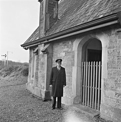 Station Master Nolan standing in front of Lord Maude's private waiting room, Dundrum, Co. Tipperary. (National Library of Ireland on The Commons) Tags: jamespodea odeaphotographiccollection nationallibraryofireland dundrum railwaystation lordmaude privatewaitingroom stationmasternolan countytipperary lord hawarden waitingroom trainstation greatsouthernandwesternrailway dundrumhouse cornwallismaude viscounthawarden viscount baronet earldemontalt