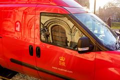 Bristol; December 2016 (Daniel Durrans) Tags: woman man urban suit window church churchdoor bristol street streetphotography reflection red van royalmail door