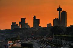 Niagara Sunset (Gary Burke.) Tags: road ca street city travel sunset vacation ontario canada tourism skyline architecture skyscraper canon buildings eos rebel niagarafalls hotel cityscape dusk north citylife canadian casino niagara wanderlust dslr touristattraction cliftonhill skylontower cityliving garyburke klingon65 t1i canoneosrebelt1i