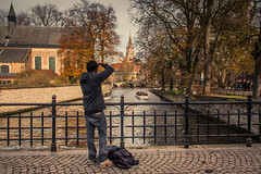 Bruges, The Dream Of The Photographers (Gilderic Photography) Tags: city bridge people man water architecture canon boat canal photographer belgium belgique belgie brugge tourist pont bruges ville beguinage 500d gilderic