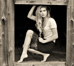 Sam D.....Portrait in barn wood in black and white (donaldbrainard1) Tags: wood light portrait feet girl monochrome face female barn canon persona photography model sam legs expression lace country posing skirt doorway barefoot 7d blonde lovely frills barnwood