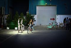Light the Way - Al Serkal Ave - Dubai - Leica M9-P (Sparks_157) Tags: leica city people urban bike bicycle lady lowlight dubai market uae naturallight streetlife rangefinder streetscene arabia handheld arrow amit warehouses streetmarket leicam9 50mmf14summilux m9p amitkar