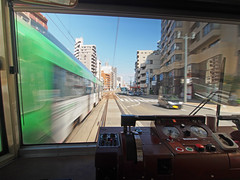 Tram in downtown Hiroshima, Japan (Tamas V) Tags: tram rail train commute traffic downtown urban city japan japanese asia asian hiroshima hiroshimaprefecture prefecture olympus 918mm olympus918mm m43 43 micro four thirds fourthirds microfourthirds oly wide angle wideangle ultrawide ultra motion blur motionblur track tracks slowshutter travel traveling travelling commuting rushhour rush hour window controls transport transportation gauge gauges throttle speed speeding quick mft building apartment office stock image photo photograph photography photojournalism stockimage stockphotograph stockphotography travelphotograph istock getty images gettyimages 918 uwa explore