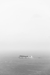 Little islands (lorenzoviolone) Tags: agfascala200 bw blackwhite blackandwhite d5200 dslr monochrome nikon nikond5200 reflex rocks seascape vsco vscofilm clearsky horizon horizononthewater island mist sea seaside sky travel:malta=aug2016 addingli malta