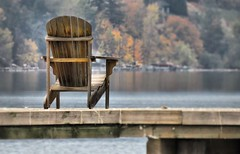 Alone (tonywild241) Tags: park autumn lake canada beach water landscape pier dock pond chair fallcolor britishcolumbia scenic coldstream mostviewed vernonbc okanaganbc alotofwater smallwaters