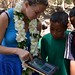 Rebecca of Samoa Conservation Society showing kids images of endangered birds.  Photo credit: UNDP/GEF-SGP