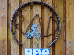 RAD (Steve Taylor (Photography)) Tags: rad chain wheel art sculpture sign streetart blue brown white metal rust wood newzealand nz southisland canterbury christchurch cbd city grain nail cycle bicycle bike cyclist thecommons