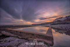Watchet Sunrise. (Emily_Endean_Photography) Tags: somerset watchet beach coast rock ocean pool reflections sea seascape sunrise clouds colours lighthouse town seaside longexposure lee leefilters filters bigstopper
