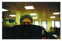 Office (JamesAlexanderThorne) Tags: olympus trip 35 london england office work face eyes chair fujifilm