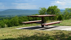 Picnic table at Sideling Hill Welcome Center (SchuminWeb) Tags: schuminweb ben schumin web september 2016 maryland md sidelinghill sideling hill washington county 68 i68 interstate rest area overlook scenic view welcome center picnic table tables pennsylvania pa fulton mountain mountains trees cloud clouds forest forests areas stop stops over look