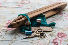 Crafty (cathbooton) Tags: button weave canon6d canonusers canoneos 50mm depthoffield scissors indoor india fabric floral loom spool sewing cotton ribbon handcrafted crafting crafts thimble yards metres velvet bird