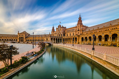 Plaza de Espana - Sevilla (Corentin Louis) Tags: nikontop nikonphotographers nikon nikond5100 nikonfrance nikonphotography nikonowners nikonfr nikkor nikonespana tokina tokina1116 tokina116 uga ultagrandangle ultra wide angle ultrawideangle espagne espana seville sevilla andalousie colors color beautiful amateur amazing poselongue longexposure longueexposition clouds sky cloud water bridge pont plazadeespana plaza blue beginner beginners