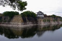 Osaka Castle Guard House (burnt dirt) Tags: osaka japan asian japanese castle osakacastle water moat house building white wall rock stone tree cloudy city town