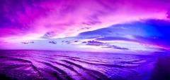 """Enjoy the Silence"" - Depeche Mode (Roland 22) Tags: sky clouds flickr shoreline sand tides waves pinks blues tones reflection sea savannahgeorgiacoast"