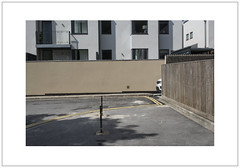 Parked (Pictures from the Ghost Garden) Tags: windows light urban cars architecture buildings landscape nikon shadows parking 28mm fences oxford oxfordshire voigtlnder urbanlandscape colorskopar d7100