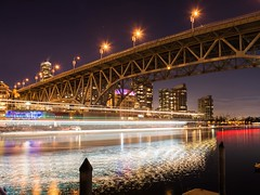 Speed of Light (Spencer Finlay) Tags: nightphotography bridge canada reflection water night vancouver speed boats boat nikon downtown ship nightimages bc harbour fast lighttrails granvilleisland vancity canadiancities granvillestreetbridge beautifulbc nikonphotographers