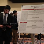 Student checks over his research notes at the Criminal Justice poster presentation.