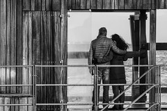 Lovers' view #2 (Vibeke Sonntag) Tags: street sea people urban bw woman man water canon copenhagen denmark couple poetry outdoor candid streetlife romance lovers dreaming scandinavia 70300mm kastrup amager walkby amagerstrand sneglen