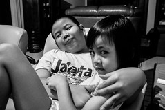 Brother and Sister in Action (okky_prisandi) Tags: kids brother sister bortherandsister grayscale 23mm portrait hitamputih bw indoor focallength balikpapan eastborneo kalimantantimur indonesia
