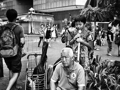 Cheeky boy . (-Faisal Aljunied-) Tags: faisalaljunied ricohgr streetphotography cheeky blackandwhite monochrome blackandwhitestreet trishawuncle singapore