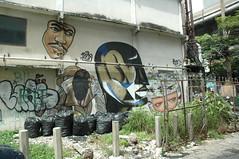 Sukhumvit Rd - Bangkok (jcbkk1956) Tags: bangkok thailand sukhumvitroad street graffiti trash grot weeds face building nikon nikkor 1870mmf3545 d70s worldtrekker streetart