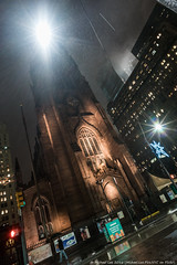 Rainy Trinity Church (20161129-DSC05687) (Michael.Lee.Pics.NYC) Tags: newyork trinitychurch broadway wallstreet night rain tilted architecture sony a7rm2 zeissloxia21mmf28