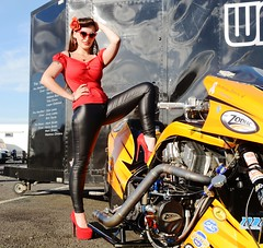 Holly_9901 (Fast an' Bulbous) Tags: drag dragster bike motorcycle top fuel nitro supertwin zodiac santa pod euro finals england girl woman hot hotty sexy chick babe biker long brunette hair black leather pvc jeans leggings tight red shoes high heels stilettos pinup model people outdoot sunglasses sunny