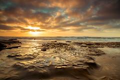Waiting Surfer (PhotoJacko - Jackie Novak) Tags: lajolla potholes sandiego tidepools surf sunset goldenhour landscape seascape canon6d california water sky clouds singhraydarylbensonreversegndfilter