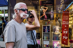 (Giovanni Stimolo) Tags: woman women window eyes eyecontact expression eye red yellow urban cyan panasoniclumixdmclx3 people portrait arms arm advertising streetphotography street streetportrait dmclx3 face fashon girl glass hair hand head hands hat light lights look lx3 lumix city colors color clothes back man men mirror mustache glasses