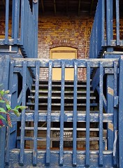 Blue Stairs (Jae at Wits End) Tags: door wood old city blue urban building brick texture abandoned broken yellow architecture stairs america outside illinois midwest stair peeling paint alone exterior outdoor decay balcony neglected flight steps entrance structure pale stairway landing doorway faded staircase forgotten american worn lone weathered opening portal railing discarded forsaken damaged left solitary alton rejected metropolitan cracked entry bleached brickwork faint outcast washedout dumped castaside discolored treads flightofsteps flightofstairs