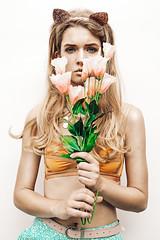 In Bloom (photögraphy.com) Tags: deleteme5 deleteme2 deleteme3 girl beautiful model mood sad hide depression bloom plasticflowers sorrow catears concerned saveme1 deleteme1
