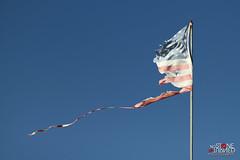 Stirred remains (No Stone Unturned Photography) Tags: sea sky america flying still wind flag united pole faded american worn states waving starsandstripes shredded tattered salton