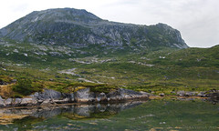 fjord's end ... (lunaryuna) Tags: summer nature weather norway reflections season landscape rocks mood hill overcast fjord lunaryuna lofotenislands summerabovethearcticcircle lofotenarchipelago fjordsend