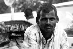 Rickshaw Puller #1 (vtuli77) Tags: street monochrome portraits canon 50mm chandigarh scottkelby niftyfifty canon450d digitalrebelxsi canondigitalrebelxsi worldwidewalk