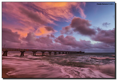Dawn's Glow (Fraggle Red) Tags: ocean clouds sunrise dawn pier waves florida windy stormy atlanticocean hdr christmasday fishingpier pompanobeach 2015 7exp canonef1635mmf28liiusm browardco dphdr christmas2015