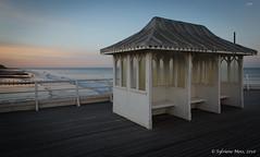 Cromer Pier - When everybody's gone home (Sylviane Moss) Tags: uk light sunset sea england evening coast pier norfolk shelter cromer