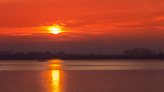 Fire ball over lagoon