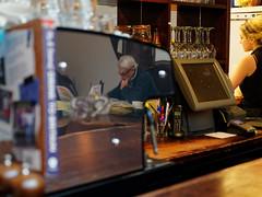 the paper (watcher330) Tags: aberystwyth ultracomida man newspaper waitress reflection