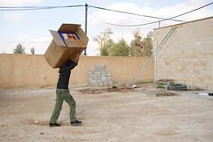 Men with blankets (ww.icmc.net) Tags: winter refugees families jordan items jordanian distribution syrian vulnerable winterization