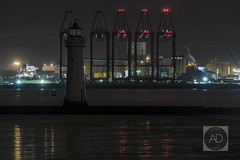Lighthouse, Heavy Cranes. (alun.disley@ntlworld.com) Tags: longexposure night reflections structures cranes shipping industriallandscape merseyside rivermersey newbrightonlighthouse liverpool2 peelports englishportsandharbours