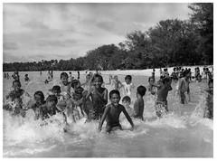 School children on a picnic enjoying the warm waters of Muri Lagoon, Rarotonga, Cook Islands.