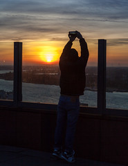 Stretching for the perfect capture (Antti Tassberg) Tags: city travel winter urban silhouette mas cityscape photographer belgium antwerp talvi antwerpen vlaanderen kaupunki belgia valokuvaaja