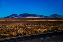 First signs (Melissa Maples) Tags: nevehir turkey trkiye asia  nikon d5100   nikkor afs 18200mm f3556g 18200mmf3556g vr kapadokya cappadocia dawn morning fields hills mountains blue road nevehir trkiye