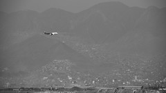 Flight Fog landing (Zahid - At Sea - Thanks for the favs and comments) Tags: monochrome blackandwhite hills city fog mist buildings cityscape hillscape planescape flightscape plane aircraft beforelanding bright misty whike black peru lanairlines lowcost skyscanner latinamerica aeroplane flight aviation landing sky mountainside mountain mountains view machine beauty day outdoor floating flying lan wheels