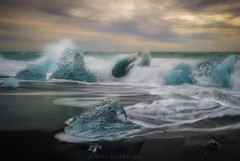 Ice jewelry (Blai Figueras) Tags: islandia sky agua seascape water horizon landscape amanecer atmosphere coast seaside longexposure sun le paraiso eden iceberg sea beach paisaje flickr playa splash ice iceland costa cielo clouds mar silkeffect