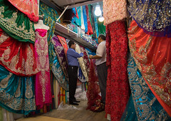Man selling dresses in the clothes bazaar, Fars province, Shiraz, Iran (Eric Lafforgue) Tags: 2people 40sadult adultsonly bazaar bazar business choice clothes colorimage colorful commerce dresses hanging historic horizontal indoors iran iranian market menonly middleeast multicolored people persia persian photography retail selling shiraz shop shopping shops store stores textile trade trading traveldestinations twopeople variation vendor farsprovince
