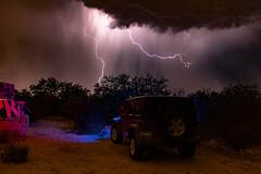 Grafitti, Lightning, and a Jeep (aramirezpho) Tags: arizona storm lightpainting rain clouds danger grafitti desert monsoon lightning voltage wrangler lte lngexponering udallpark morriskudallpark