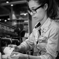 Carmen At Work (dave:w:) Tags: portrait costa white black london cup coffee girl monochrome shop work 35mm mono glasses spain spanish busy manager job spectacles carmen fuentes studious rayban diligence diligent precise manageress fastidious a6000