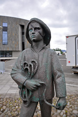 a statue turned into a pirate outside The Hof in Akureyri